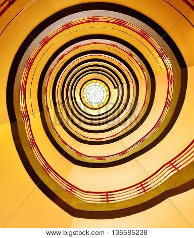 Spiral stairs or staircase with warm light.