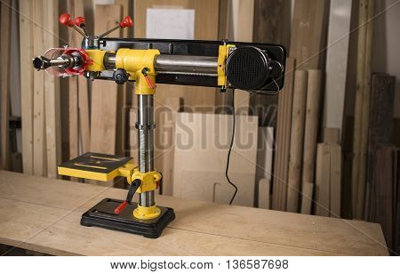 Vertical drilling machine on table with tools