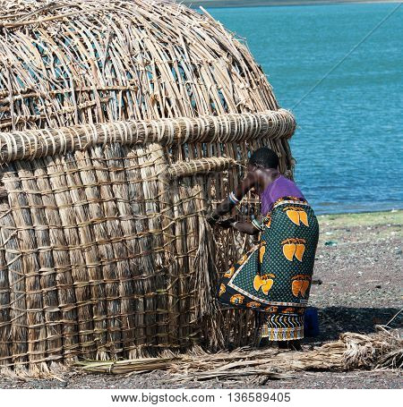 African Woman Makes Traditional Hut