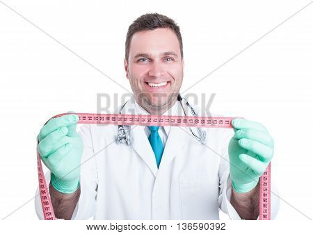 Male Doctor Holding Body Ruler And Smiling