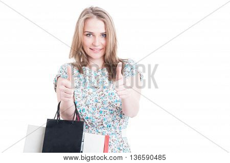 Portrait Of Cheerful Girl Showing Thumb Up