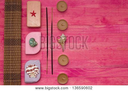soap bar and bamboo mat with incense sticks composition