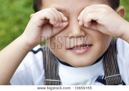 Boy Covering Eyes
