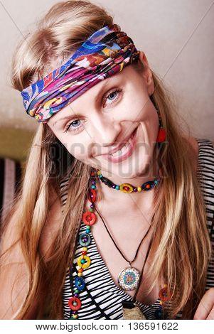Portrait of a happy hippie girl. Shooting in studio. Toned image