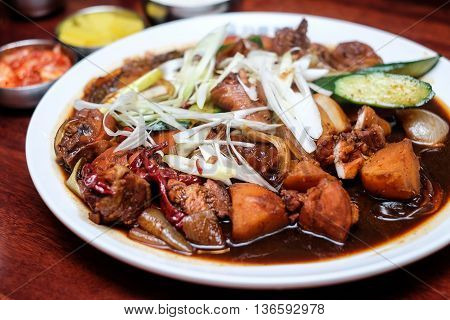 Plate of braised pork in malay style
