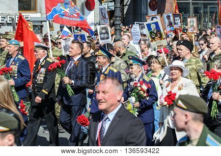 St. Petersburg, Russia - 9 May, Procession of people with flowers and portraits, 9 May, 2016. Holiday-action