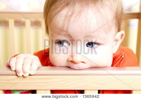 Baby In Bitting On Crib