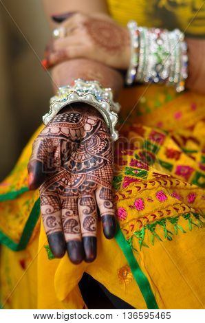 Close view of an Indian woman's hand with henna tattoos