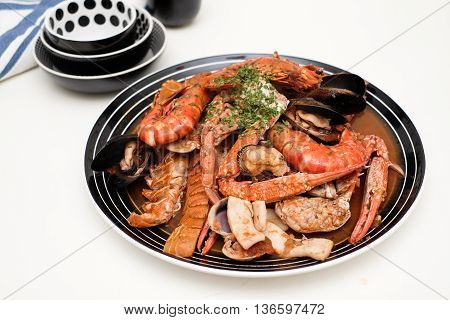 Dish of seafood with crabs shrimps clams lobster and squids
