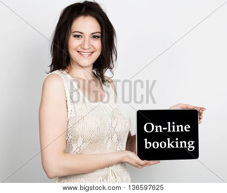 technology, internet and networking - close-up successful woman holding a tablet pc with on-line booking sign. internet technology in tourism.
