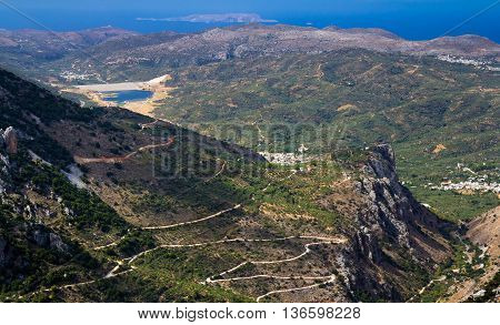 Mountains of the island of Crete and winding road. The view from the pass