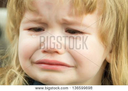 Little Boy Cries With Tears