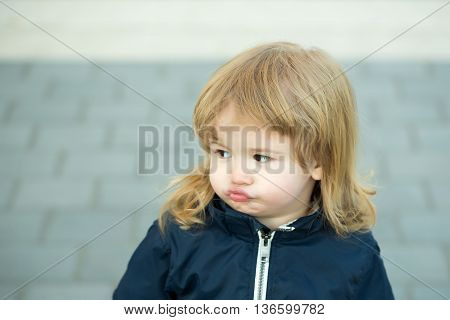Little Boy With Pouted Lips