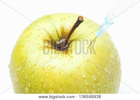 Green Apple With Syringe Isolated