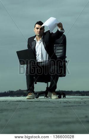 Businessman With Laptop And Paper Outdoor