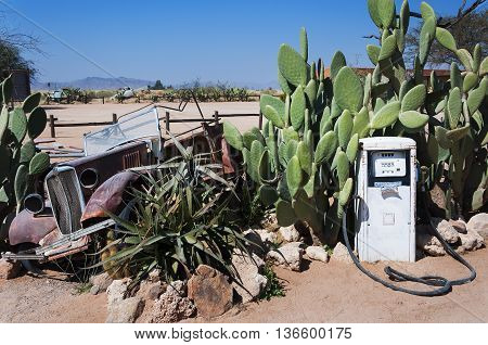 An abandoned gas pump and old car in Solitaire Namibia