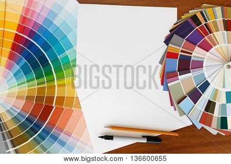 Two color palette guide on the wooden background and the white sheet of paper. mockup template