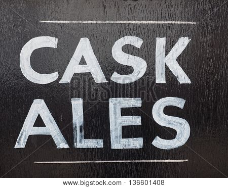 Cask ales sign outside a British pub serving real ale