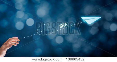 Idea and creative process concept. Businessman throw a paper plane symbolizing creativity improvement.