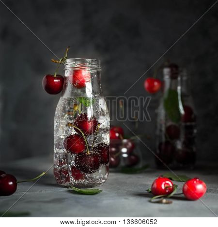 Cherry lemonade with ice and soda. Sweet Refreshing Close up