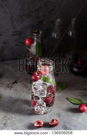 Cherry lemonade with ice and soda. Sweet Refreshing Vertical shooting