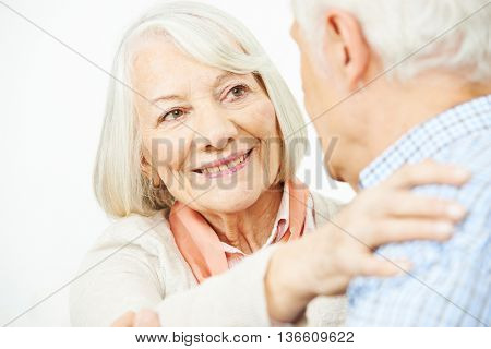 Happy senior couple dancing with each other at home