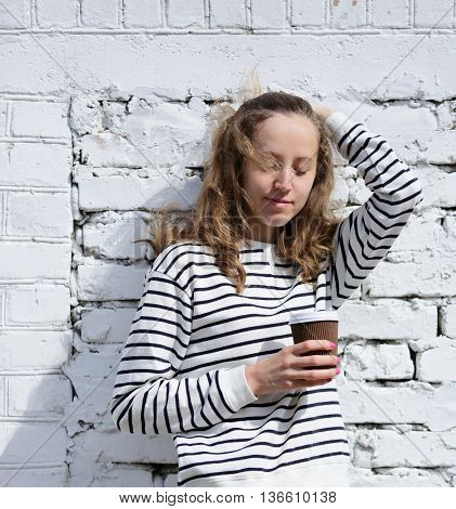 Girl With A Disposable Coffee Cup