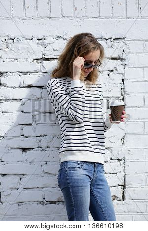 Beautiful Woman In Sunglasses With A Disposable Cofee Cup