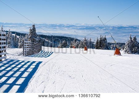 Ski resort, ski slope, people skiing down the hill, mountains view