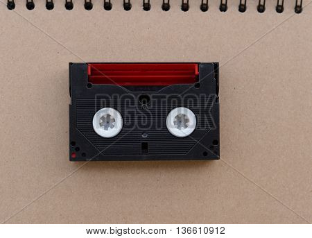 Red black Video tape in retro day brown background