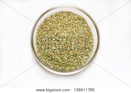 Green buckwheat in a glass bowl. Superfood. Top view.
