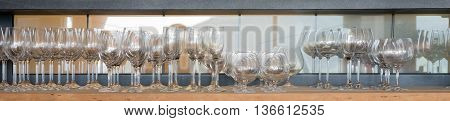 Panoramic picture of empty glasses on the shelf