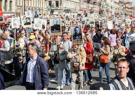 St. Petersburg, Russia - 9 May, People carrying portraits of their dead relatives, 9 May, 2016. Holiday-action