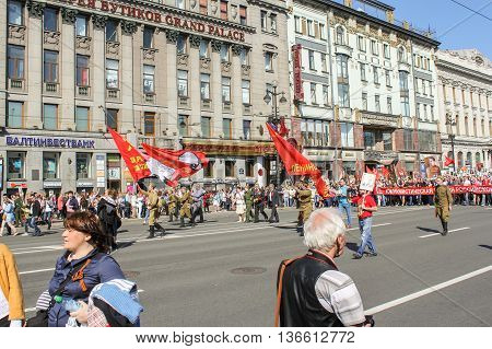 St. Petersburg, Russia - 9 May, People in military uniform under the Soviet flag, 9 May, 2016. Holiday-action