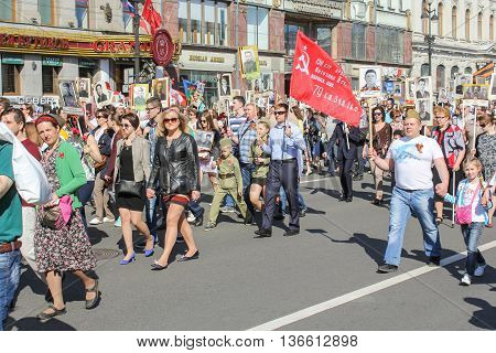 St. Petersburg, Russia - 9 May, People with photographs and the flag of victory, 9 May, 2016. Holiday-action