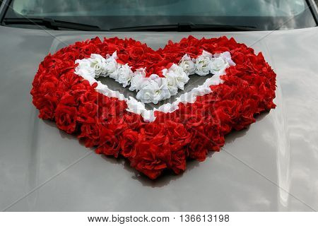 Decoration of wedding car as a heart of red roses