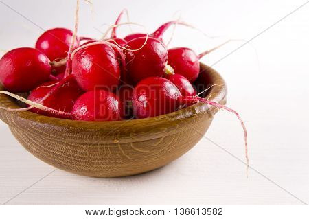 red radish and Fresh in a wooden bowl