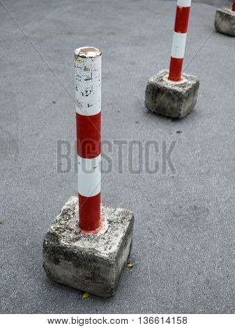 parking blockage device made by steel and concrete in red and white