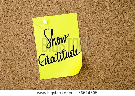 Show Gratitude Written On Yellow Paper Note