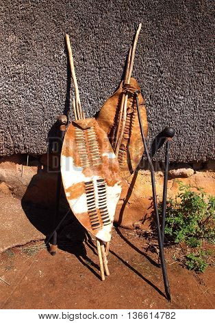 Close-up South African Zulu spears warrior leather shields and assegai. Traditional tribal ethnic weapon.