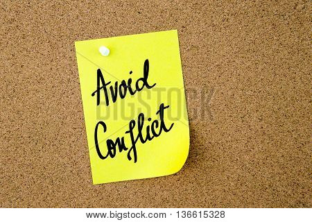 Avoid Conflict Written On Yellow Paper Note