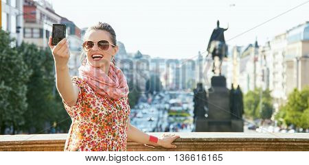 Smiling Young Woman Taking Selfie With Digital Camera In Prague