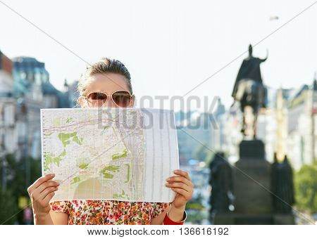 Woman Hiding Behind Map While Standing At Wenceslas Square