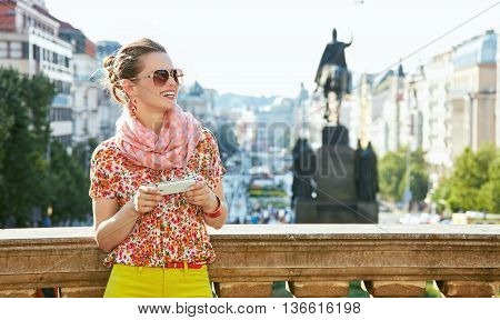 Woman With Smartphone Standing Near National Museum In Prague