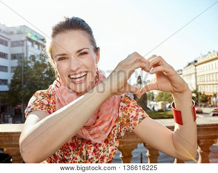 Smiling Young Woman Showing Heart Shaped Hands In Prague