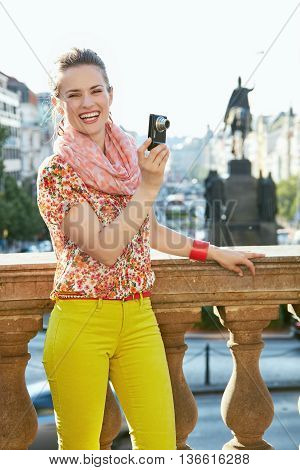 Happy Woman Taking Photos With Digital Camera In Prague
