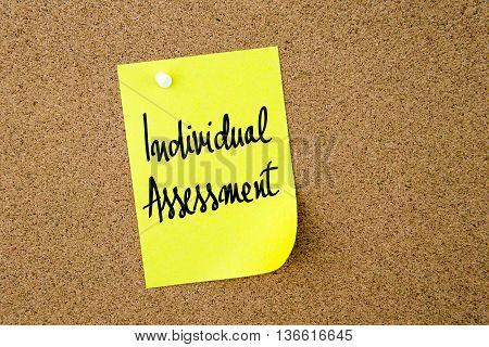 Individual Assessment Written On Yellow Paper Note