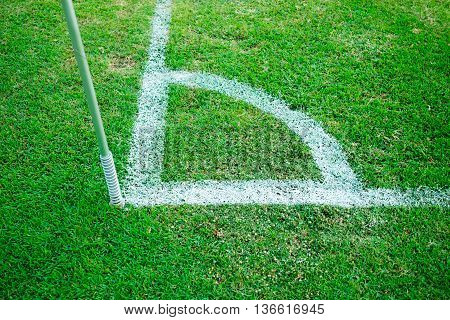 soccer field corner with white line and corner pole