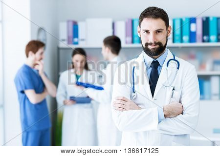 Confident Doctor Posing In The Office