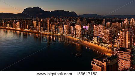 Aerial view of a Benidorm coastline. Illuminated skyscrapers at night. Costa Blanca Alicante province. Spain